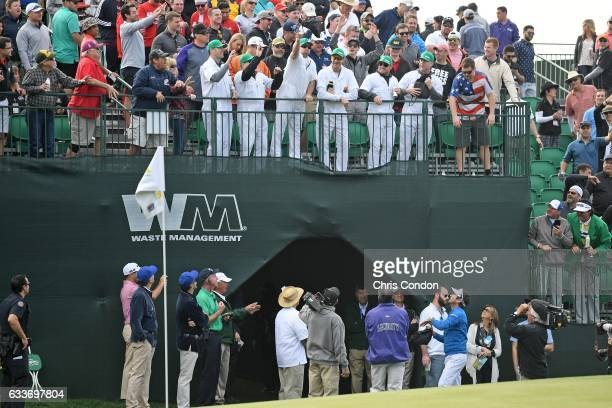 Bubba Watson birdies the 16th hole and hands out gifts to fans during the second round of the Waste Management Phoenix Open at TPC Scottsdale on...