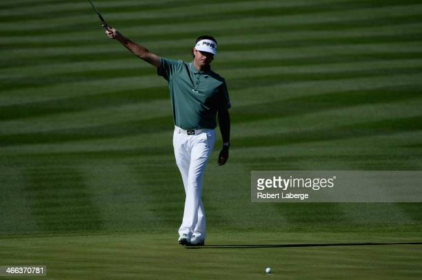 Bubba Watson celebrates a birdie on the 8th hole during the third round of the Waste Management Phoenix Open at TPC Scottsdale on February 1 2014 in...