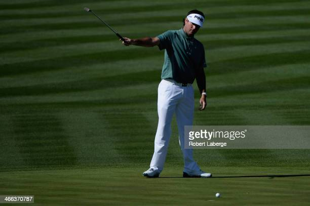 Bubba Watson celebrates a birdie on the 8th hole during the third round of the Waste Management Phoenix Open at TPC Scottsdale on February 1, 2014 in...