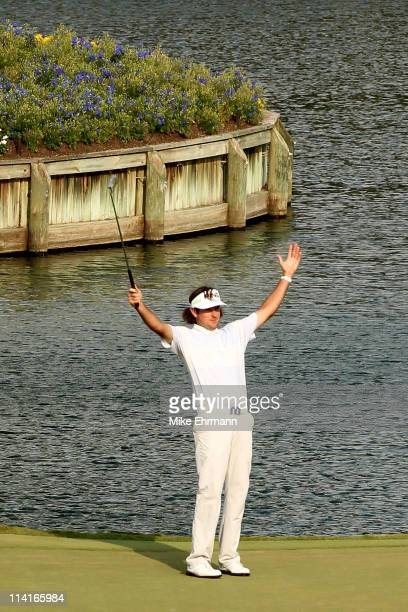 Bubba Watson celebrates chipping in for birdie on the 17th hole during the second round of THE PLAYERS Championship held at THE PLAYERS Stadium...