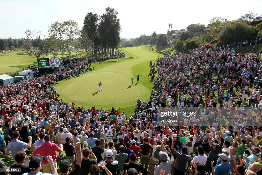 Bubba Watson celebrates his birdie putt on the 18th green to win the final round of the Northern Trust Open at the Riviera Country Club on February 16, 2014 in Pacific Palisades, California.