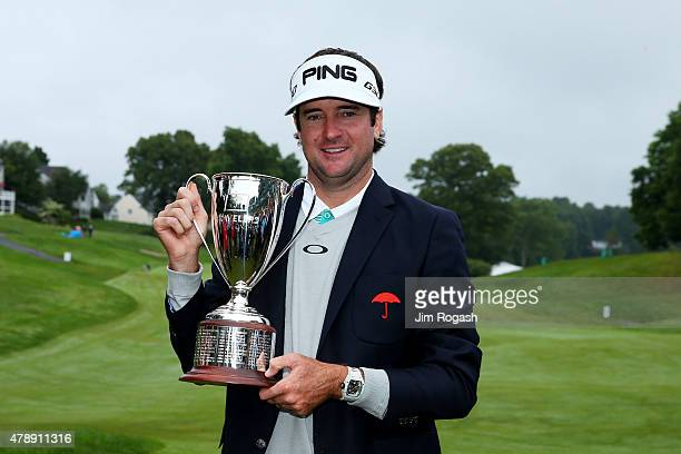 Bubba Watson celebrates with the winner's trophy after the final round of the Travelers Championship at TPC River Highlands on June 28, 2015 in...