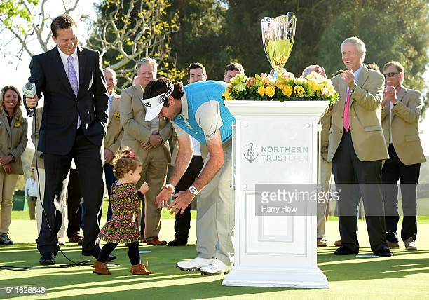 Bubba Watson goes to hug his daughter Dakota during the trophy presentation after putting in to win on the 18th hole during the final round of the...