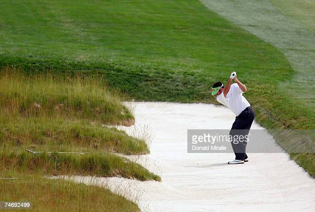 Bubba Watson hits a a shot out of the church pew bunkers on the fourth hole during the final round of the 107th US Open Championship at Oakmont...