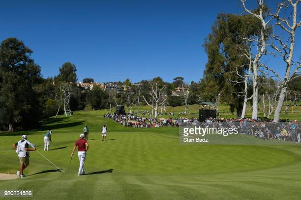 Bubba Watson hits a putt on the sixth hole during the final round of the Genesis Open at Riviera Country Club on February 18, 2018 in Pacific...