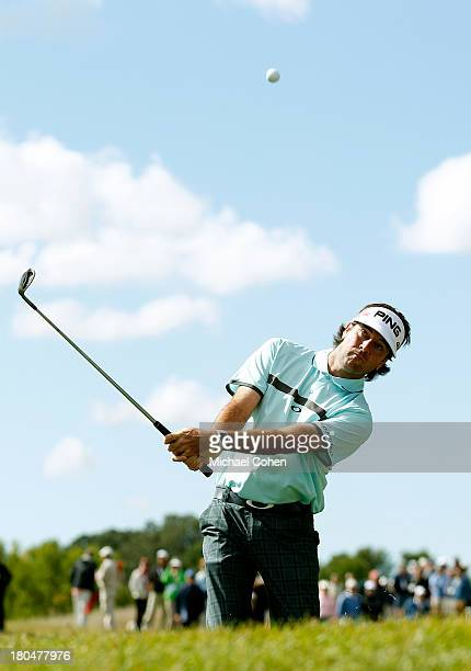 Bubba Watson hits onto the first green during the Second Round of the BMW Championship at Conway Farms Golf Club on September 13, 2013 in Lake...