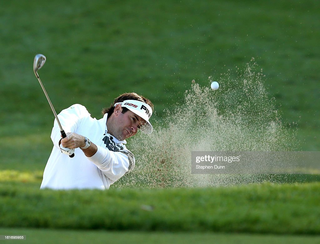 Bubba Watson hits out of a bunker on the 14th hole during the first round of the Northern Trust Open at Riviera Country Club on February 14, 2013 in Pacific Palisades, California.