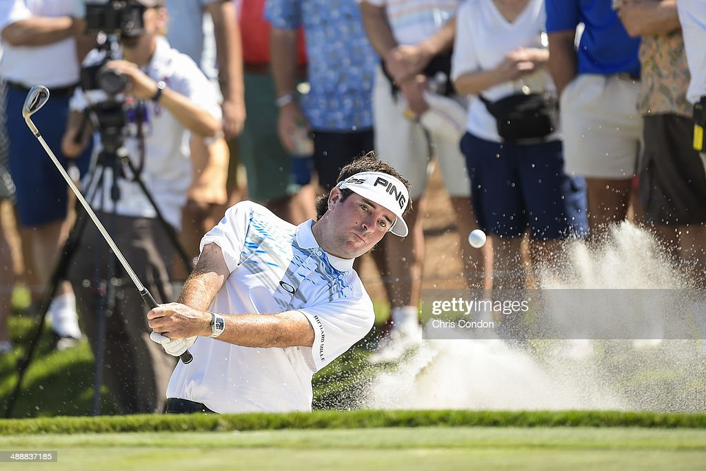 Bubba Watson hits out of a green-side bunker on the ninth hole during the first round of THE PLAYERS Championship on THE PLAYERS Stadium Course at TPC Sawgrass on May 8, 2014 in Ponte Vedra Beach, Florida.