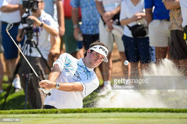 Bubba Watson hits out of a green-side bunker on the ninth hole during the first round of THE PLAYERS Championship on THE PLAYERS Stadium Course at...