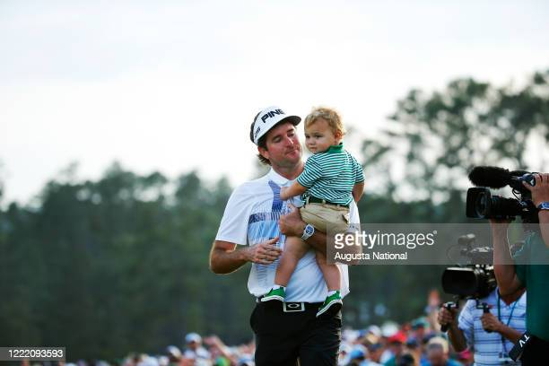 Bubba Watson holds his son, Caleb, after winning the 2014 Masters Tournament on Sunday, April 13, 2014.