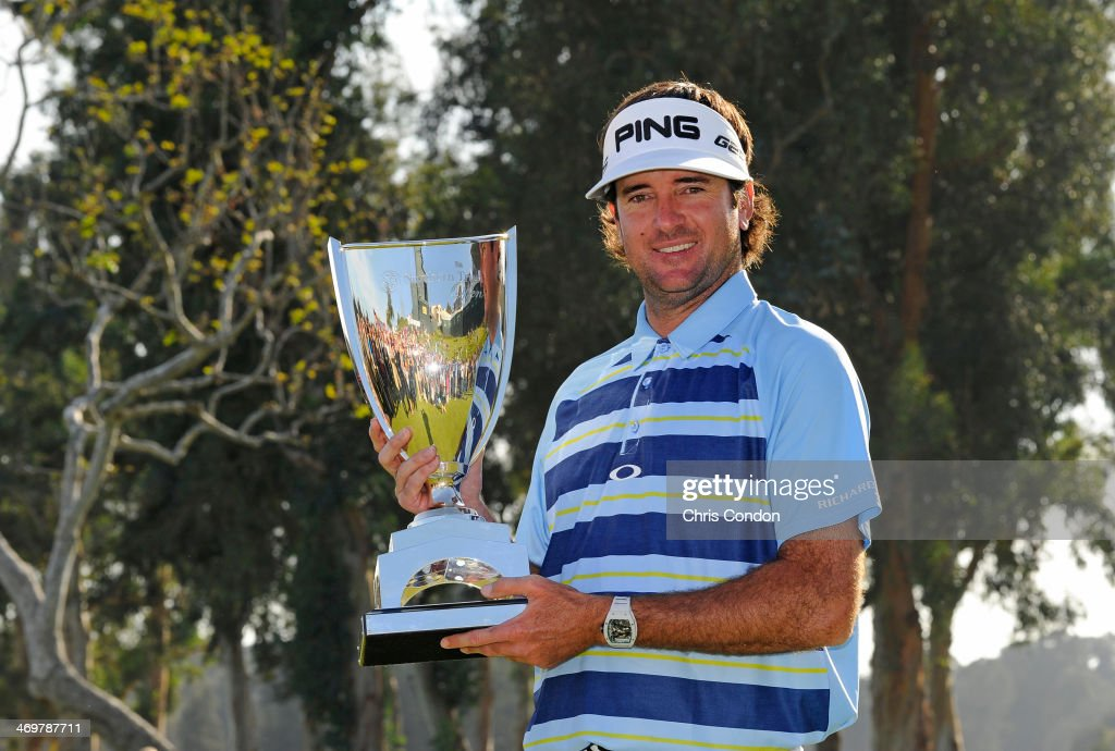 Bubba Watson holds the tournament trophy after winning the Northern Trust Open at Riviera Country Club on February 16, 2014 in Pacific Palisades, California.