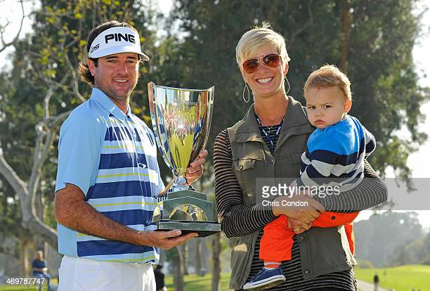 Bubba Watson holds the tournament trophy with his wife Angie and son Caleb after winning the Northern Trust Open at Riviera Country Club on February...