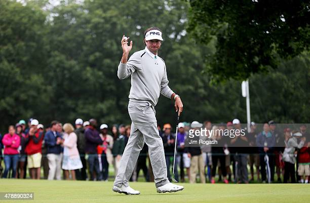 Bubba Watson holds up his ball after putting on the fourth green during the final round of the Travelers Championship at TPC River Highlands on June...
