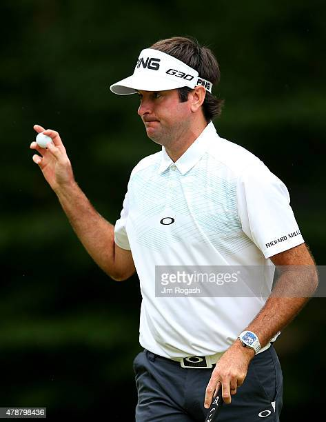 Bubba Watson holds up his ball after putting on the tenth green during the third round of the Travelers Championship at TPC River Highlands on June...