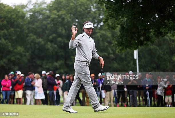 Bubba Watson holds up his ball on the 15th green during the final round of the Travelers Championship at TPC River Highlands on June 28 2015 in...