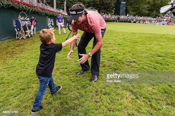 Bubba Watson hugs his son Caleb on the 18th hole green following the final round of the TOUR Championship by Coca-Cola, the final event of the...