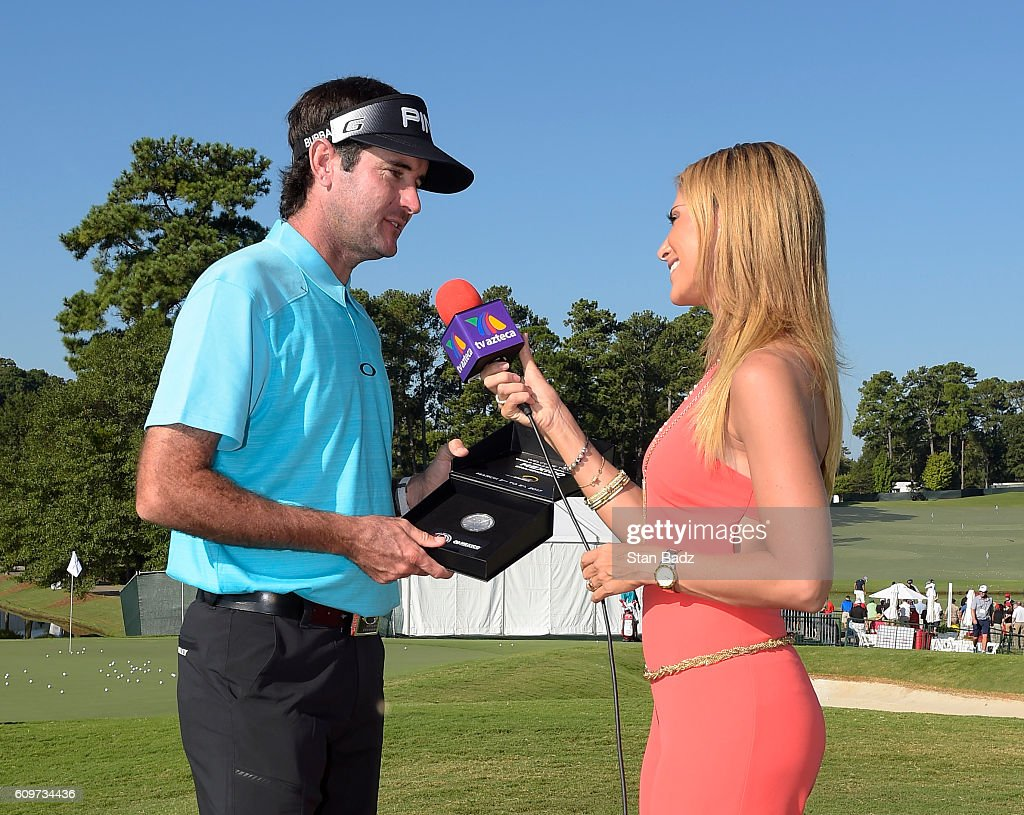 Bubba Watson is presented a WGC Mexico Championship silver coin from Ines Soinz during practice for the TOUR Championship, the final event of the FedExCup Playoffs, at East Lake Golf Club on September 20, 2016 in Atlanta, Georgia.
