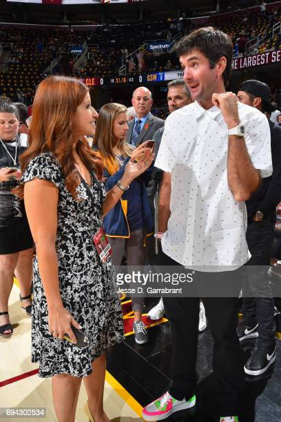 Bubba Watson is seen talking to Rachel Nichols ESPN reporter before the game of the Golden State Warriors and the Cleveland Cavaliers in Game Three...