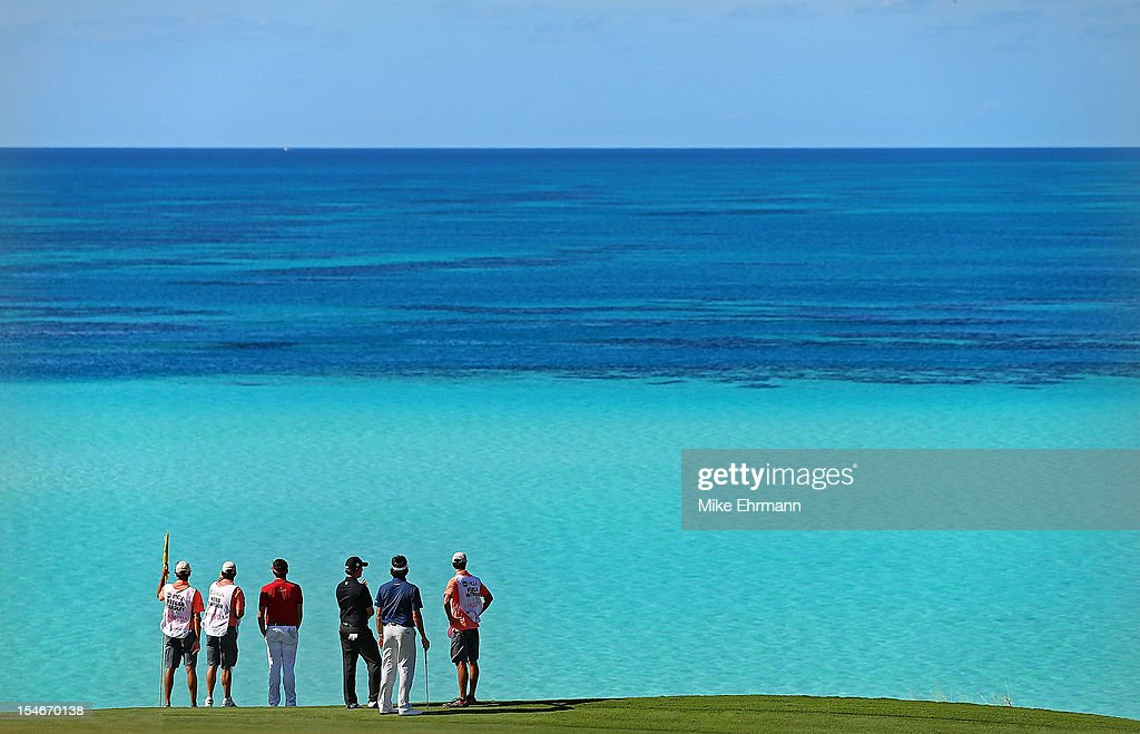 Bubba Watson, Keegan Bradley, Webb Simpson look out over the water on the eighth hole during the final round of the PGA Grand Slam of Golf at Port Royal Golf Course on October 24, 2012 in Southampton, Bermuda.
