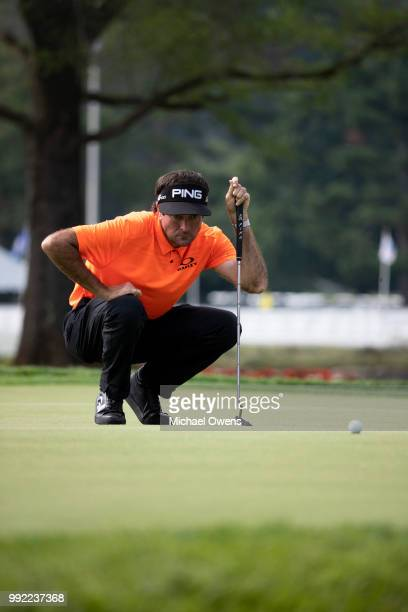 Bubba Watson lines up his par putt during round one of A Military Tribute At The Greenbrier at the Old White TPC course on July 5 2018 in White...