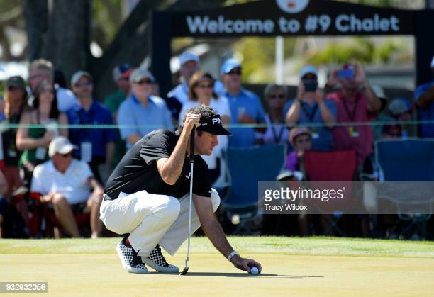 Bubba Watson lines up his putt at hole No 9 during the second round of the Arnold Palmer Invitational presented by MasterCard at Bay Hill Club and...