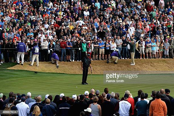 Bubba Watson misses a putt on the 18th hole to lose to Kevin Stadler in the final round of the Waste Management Phoenix Open at TPC Scottsdale on...