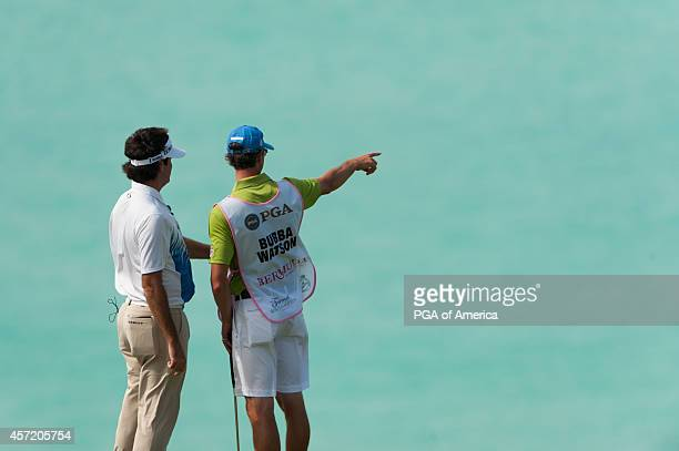 Bubba Watson of the United States and caddie Ted Scott look out at the water on the eighth hole during the First Round of Play for the 32nd PGA Grand...