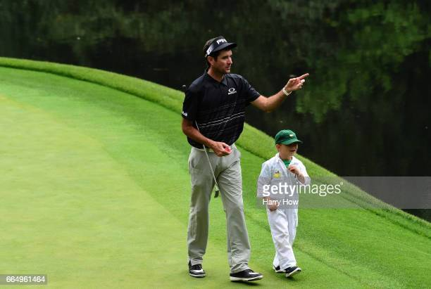 Bubba Watson of the United States and his son Caleb walk during the Par 3 Contest prior to the start of the 2017 Masters Tournament at Augusta...