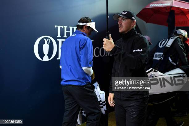 Bubba Watson of the United States and Matt Wallace of England prepare to walk out onto the 1st tee during round two of the Open Championship at...