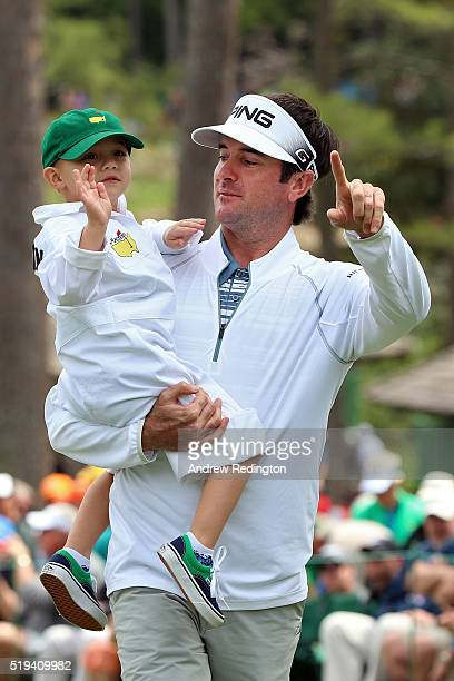 Bubba Watson of the United States carries his son Caleb during the Par 3 Contest prior to the start of the of the 2016 Masters Tournament at Augusta...