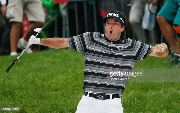 Bubba Watson of the United States celebrates after holing a bunker shot on the 18th hole for eagle during the final round of the WGC HSBC Champions...