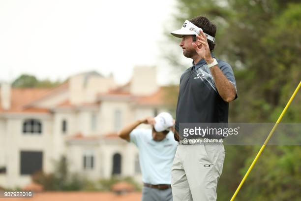 Bubba Watson of the United States celebrates on the 12th green after defeating Kevin Kisner of the United States 7&6 to win during the final round of...