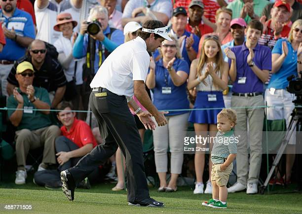 Bubba Watson of the United States celebrates with his son Caleb on the 18th green after winning the 2014 Masters Tournament by a three-stroke margin...