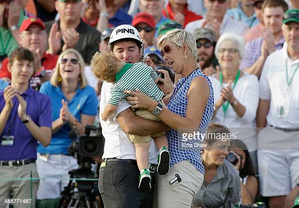 Bubba Watson of the United States celebrates with his wife Angie and their son Caleb on the 18th green after winning the 2014 Masters Tournament by a...