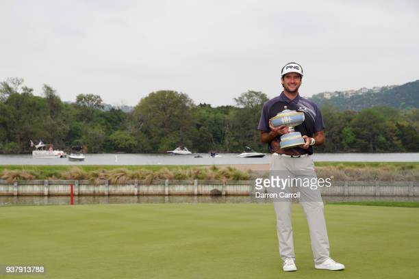 Bubba Watson of the United States celebrates with the Walter Hagen Cup after defeating Kevin Kisner of the United States 76 to win the World Golf...