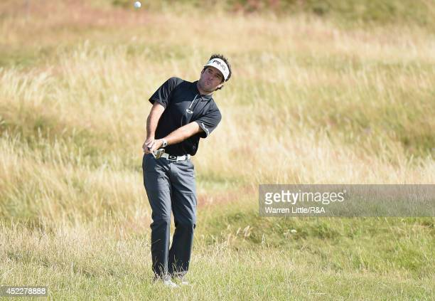 Bubba Watson of the United States chips to the 11th green during the first round of The 143rd Open Championship at Royal Liverpool on July 17 2014 in...