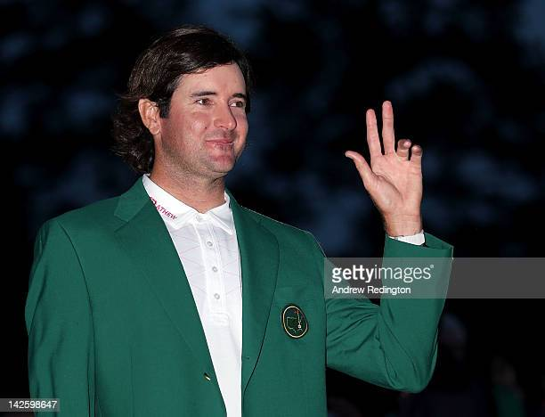 Bubba Watson of the United States gestures after his onestroke playoff victory to win the 2012 Masters Tournament during the green jacket...