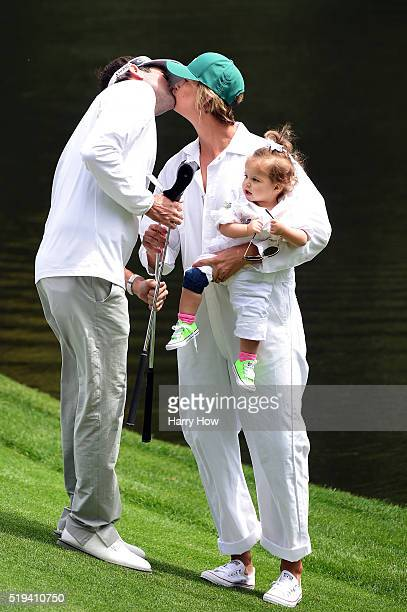 Bubba Watson of the United States his wife Angie and their children Caleb and Dakota during the Par 3 Contest prior to the start of the of the 2016...