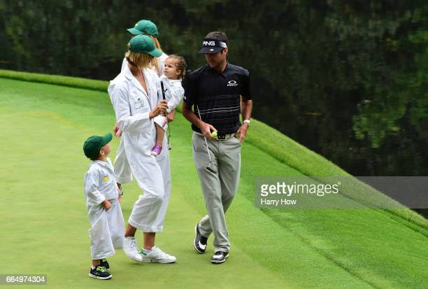 Bubba Watson of the United States, his wife Angie, daughter Dakota and son Caleb walk during the Par 3 Contest prior to the start of the 2017 Masters...
