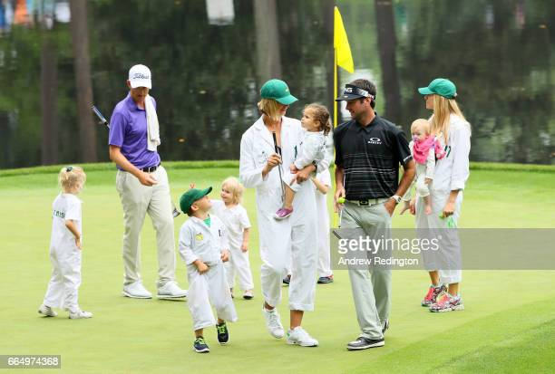 Bubba Watson of the United States his wife Angie daughter Dakota and son Caleb walk during the Par 3 Contest prior to the start of the 2017 Masters...