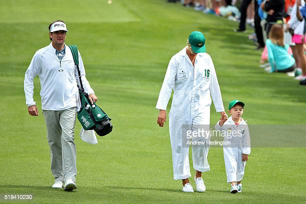 Bubba Watson of the United States his wife Angie Watson and their Caleb during the Par 3 Contest prior to the start of the of the 2016 Masters...