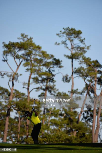 Bubba Watson of the United States hits his approach shot on the 17th hole during the first round of the 2014 Masters Tournament at Augusta National...