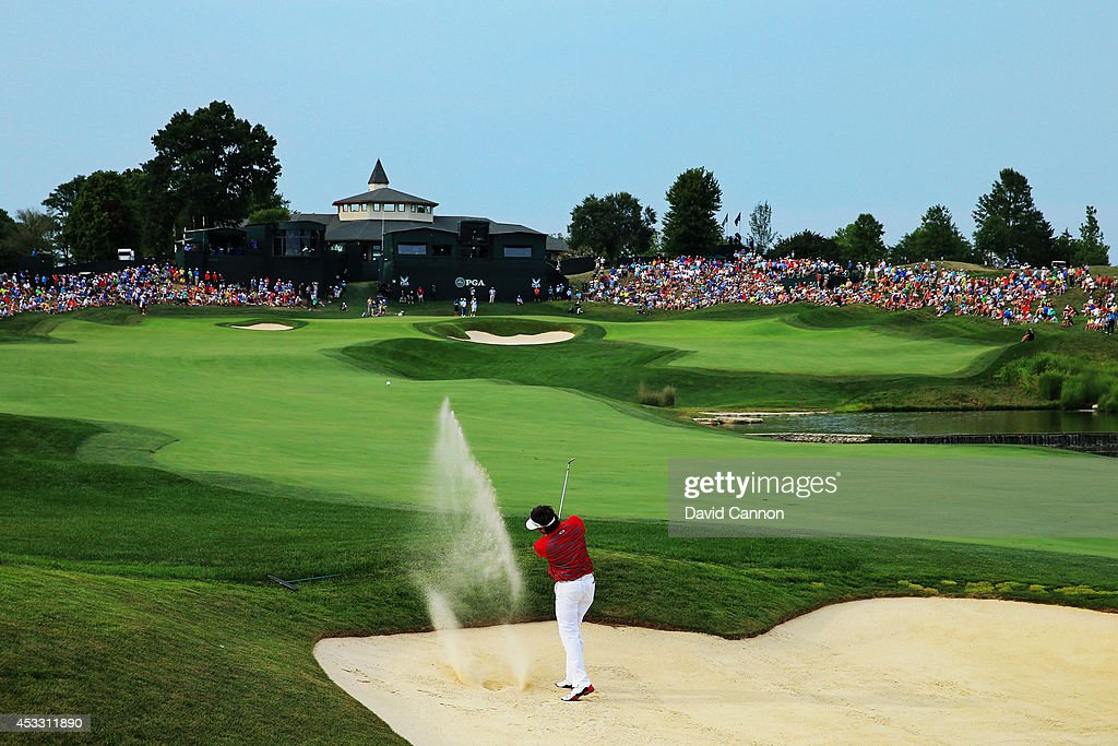 Bubba Watson of the United States hits his second shot from a fairway bunker on the 18th hole during the first round of the 96th PGA Championship at Valhalla Golf Club on August 7, 2014 in Louisville, Kentucky.