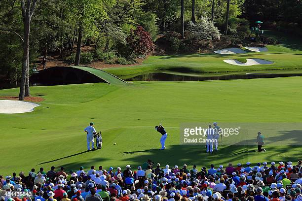 Bubba Watson of the United States hits his tee on the 12th hole during the third round of the 2014 Masters Tournament at Augusta National Golf Club...