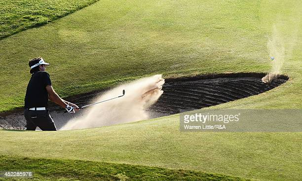 Bubba Watson of the United States hits the lip of the bunker and leaves it in the trap on the 18th hole during the first round of The 143rd Open...