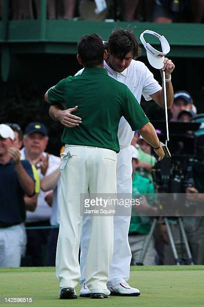 Bubba Watson of the United States hugs Louis Oosthuizen of South Africa after Watson won their sudden death playoff on the second playoff hole to win...