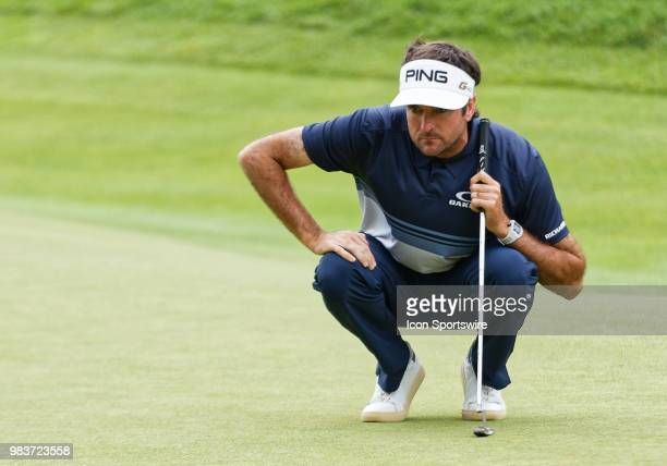 Bubba Watson of the United States lines up his putt on 18 during the Final Round of the Travelers Championship on June 24 2018 at TPC River Highlands...