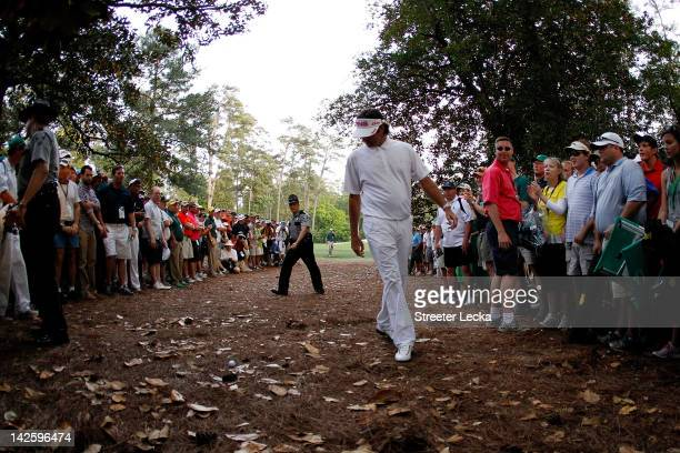 Bubba Watson of the United States looks at a shot from the rough on second sudden death playoff hole on the 10th during the final round of the 2012...