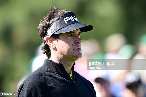 Bubba Watson of the United States looks on after playing his shot from the eighth tee during a practice round prior to the start of the 2016 Masters...