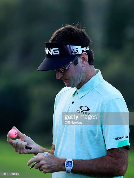 Bubba Watson of the United States marks his ball prior to play during the third round of the SBS Tournament of Champions at the Plantation Course at...